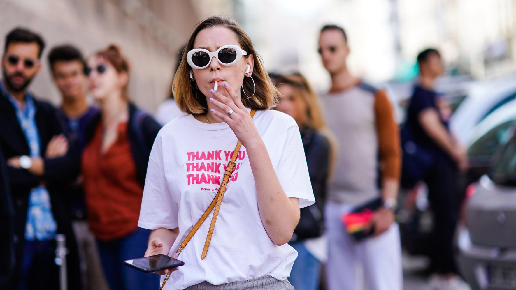 """PARIS, FRANCE - JUNE 23:  A guest wears a white t-shirt with printed words """"thank you"""", white sunglasses, outside Wooyoungmi, during Paris Fashion Week - Menswear Spring-Summer 2019, on June 23, 2018 in Paris, France.  (Photo by Edward Berthelot/Getty Images)"""
