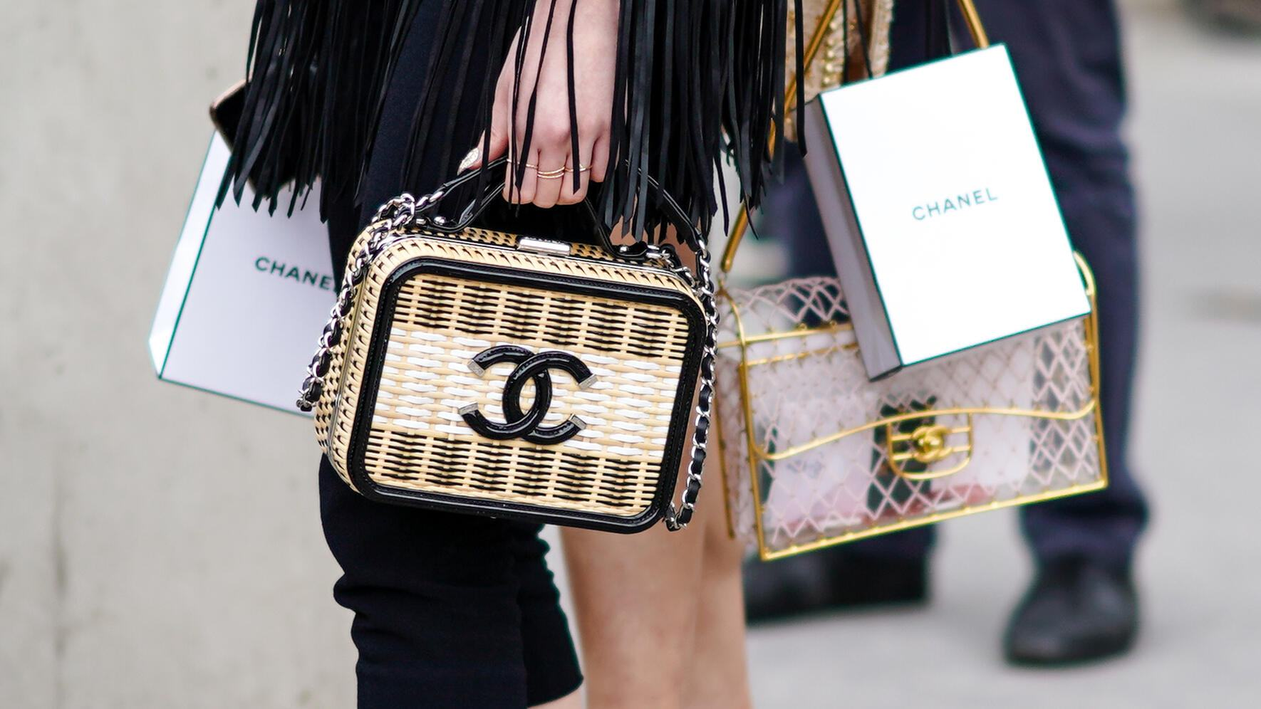 PARIS, FRANCE - MAY 03: A guest wears a Chanel vanity bag,  outside the Chanel Cruise Collection 2020  At Grand Palais on May 03, 2019 in Paris, France. (Photo by Edward Berthelot/Getty Images )