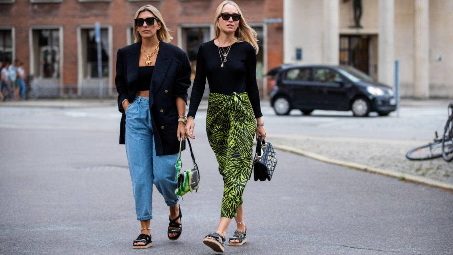 COPENHAGEN, DENMARK - AUGUST 08: Aylin König is seen wearing denim jeans, cropped top, blazer, Prada bag, sandals and Juliane Diesner wearing skirt with jungle print outside Saks Potts during Copenhagen Fashion Week Spring/Summer 2020 on August 08, 2019 in Copenhagen, Denmark. (Photo by Christian Vierig/Getty Images)