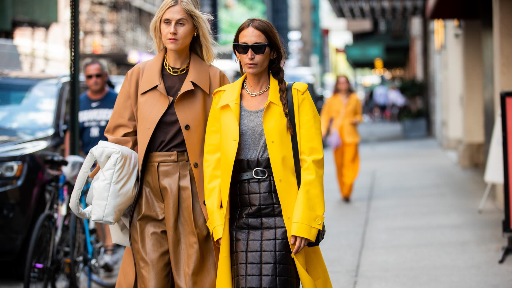 NEW YORK, NEW YORK - SEPTEMBER 08: Linda Tol wearing brown skirt, coat and Chloé Harrouche wearing yellow coat, back skirt seen outside Tibi during New York Fashion Week September 2019 on September 08, 2019 in New York City. (Photo by Christian Vierig/Getty Images)