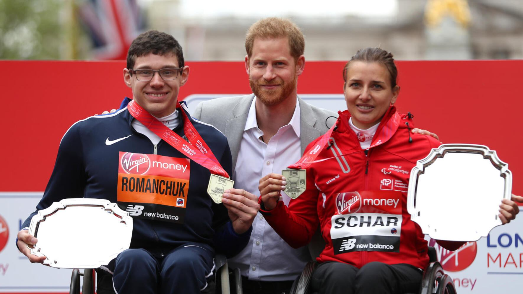 LONDON, ENGLAND - APRIL 28: Daniel Romanchuk of the USA and Manuela Schar of Switzerland pose for a photo with Prince Harry, Duke of Sussex after both winning their respective Wheelchair races during the 2019 Virgin Money London Marathon in the United Kingdom on April 28, 2019 in London, England. (Photo by Naomi Baker/Getty Images)