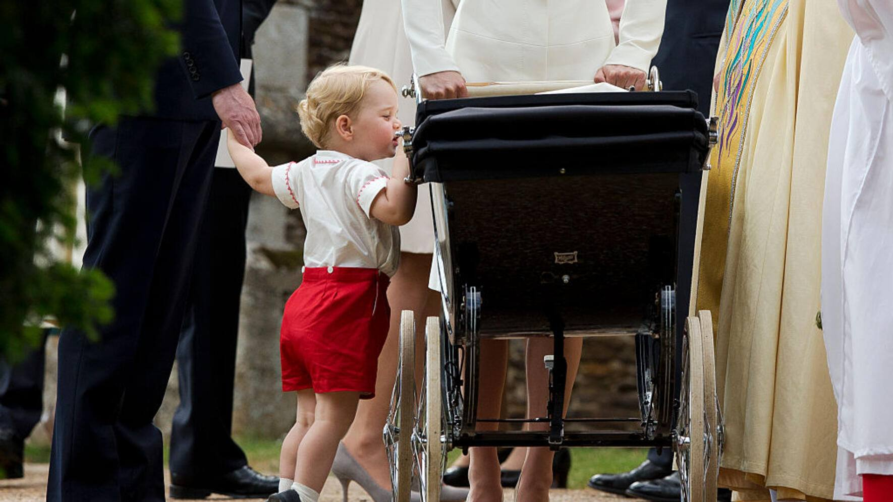 LONDON, UNITED KINGDOM - OCTOBER 04:  Prince William Giggling With His Hand Over His Mouth As He And His Baby Brother, Prince Harry, Pretend To Play The Piano During A Private Photo Session At Their Home, Kensington Palace.  (Photo by Tim Graham/Getty Images)