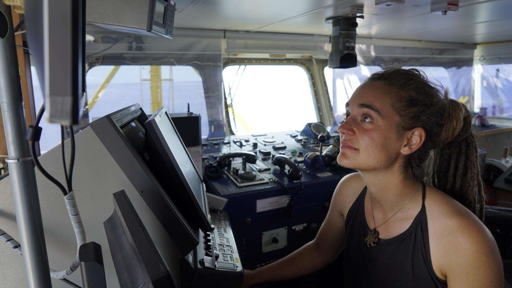 epa07676747 A handout photo made available by Sea-Watch on 27 June 2019 shows Sea-Watch 3 captain Carola Rackete on board the vessel at sea in the Mediterranean, 20 June 2019. Migrant rescue ship Sea-Watch 3, despite the threat of a fine by the Italian government, decided on 26 June 2019 to enter Italian territorial waters near the island of Lampedusa with dozens of migrants on board waiting to disembark.  EPA/TILL M. EGEN/SEA-WATCH HANDOUT  HANDOUT EDITORIAL USE ONLY/NO SALES