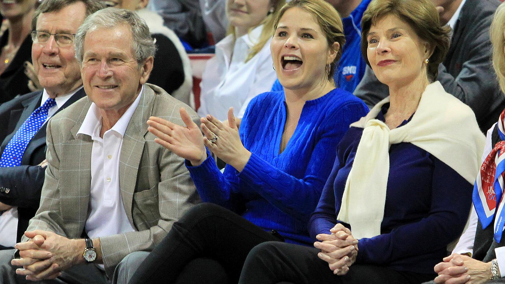 5 March 2014 - President George W. Bush, daughter Jenna Bush Hager and wife Laura Bush during the American Athletic Conference college basketball game between the SMU Mustangs and the Louisville Cardinals at Moody Coliseum in Dallas, Texas. Louisville won the game 84-71. (Photo by Matthew Visinsky/Icon SMI/Corbis via Getty Images)