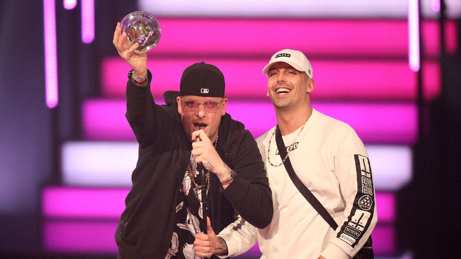 BOCHUM, GERMANY - DECEMBER 07: Bonez MC and RAF Camora speak on stage after receiving the award for best hip-hop-act during the 1Live Krone at Jahrhunderthalle on December 7, 2017 in Bochum, Germany. (Photo by Florian Ebener/Getty Images)