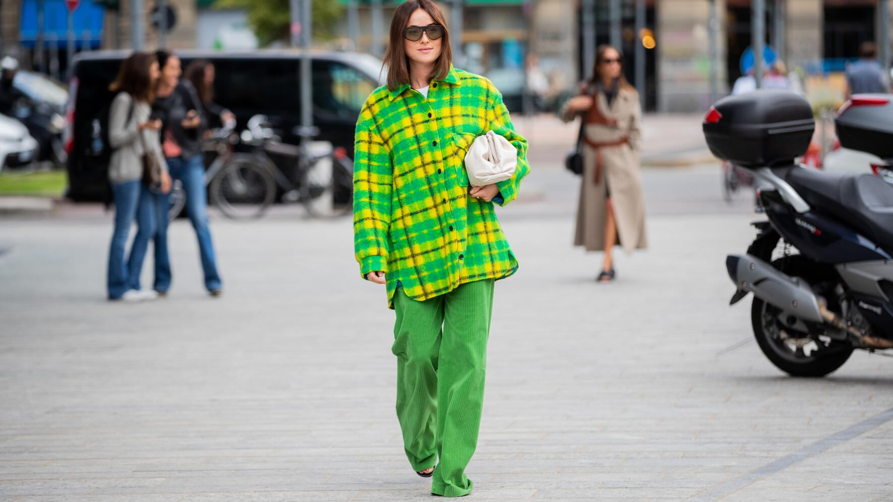 MILAN, ITALY - SEPTEMBER 20:  Lena Lademann seen wearing yellow green checkered flannel button shirt, green pants, Bottega Veneta pouch bag outside the Sportmax show during Milan Fashion Week Spring/Summer 2020 on September 20, 2019 in Milan, Italy. (Photo by Christian Vierig/Getty Images)