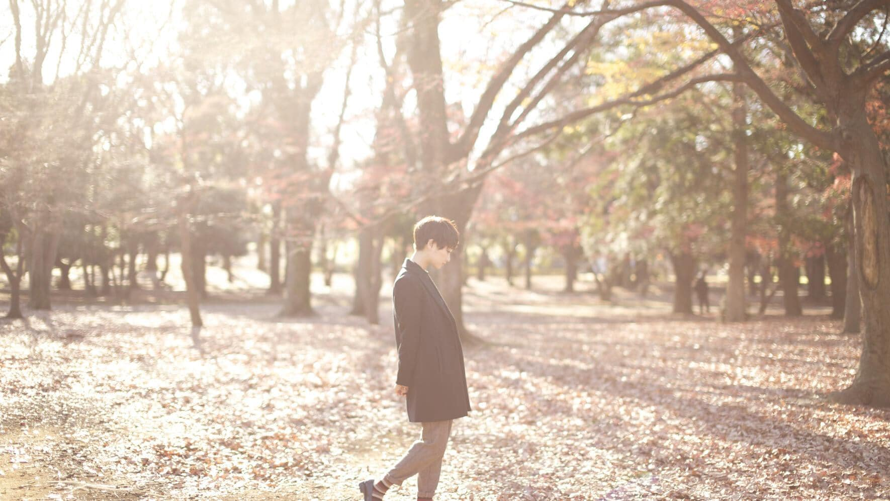 Japanese woman walks in a nature with happiness.