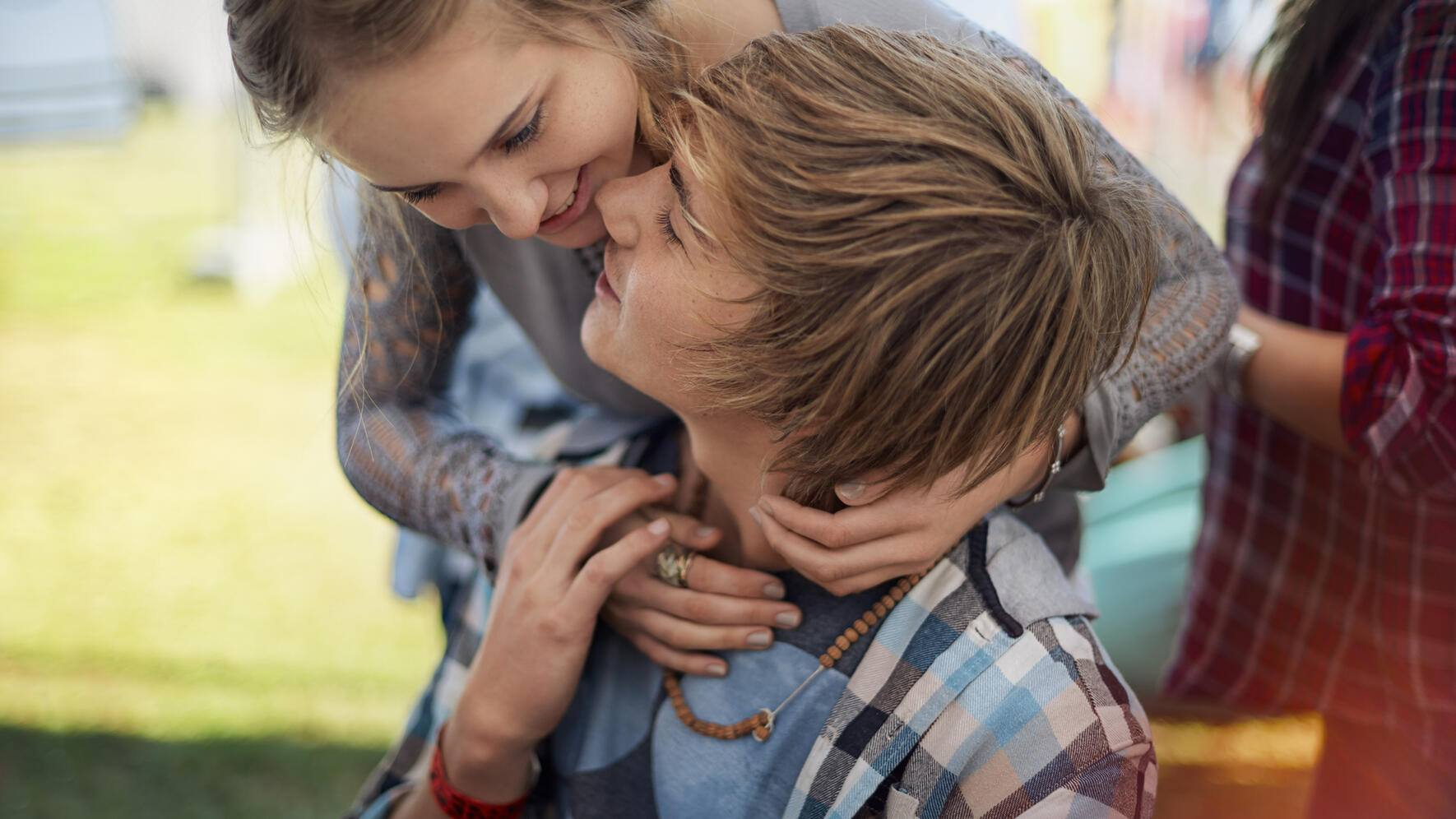 Young caucasian couple in tender embrace
