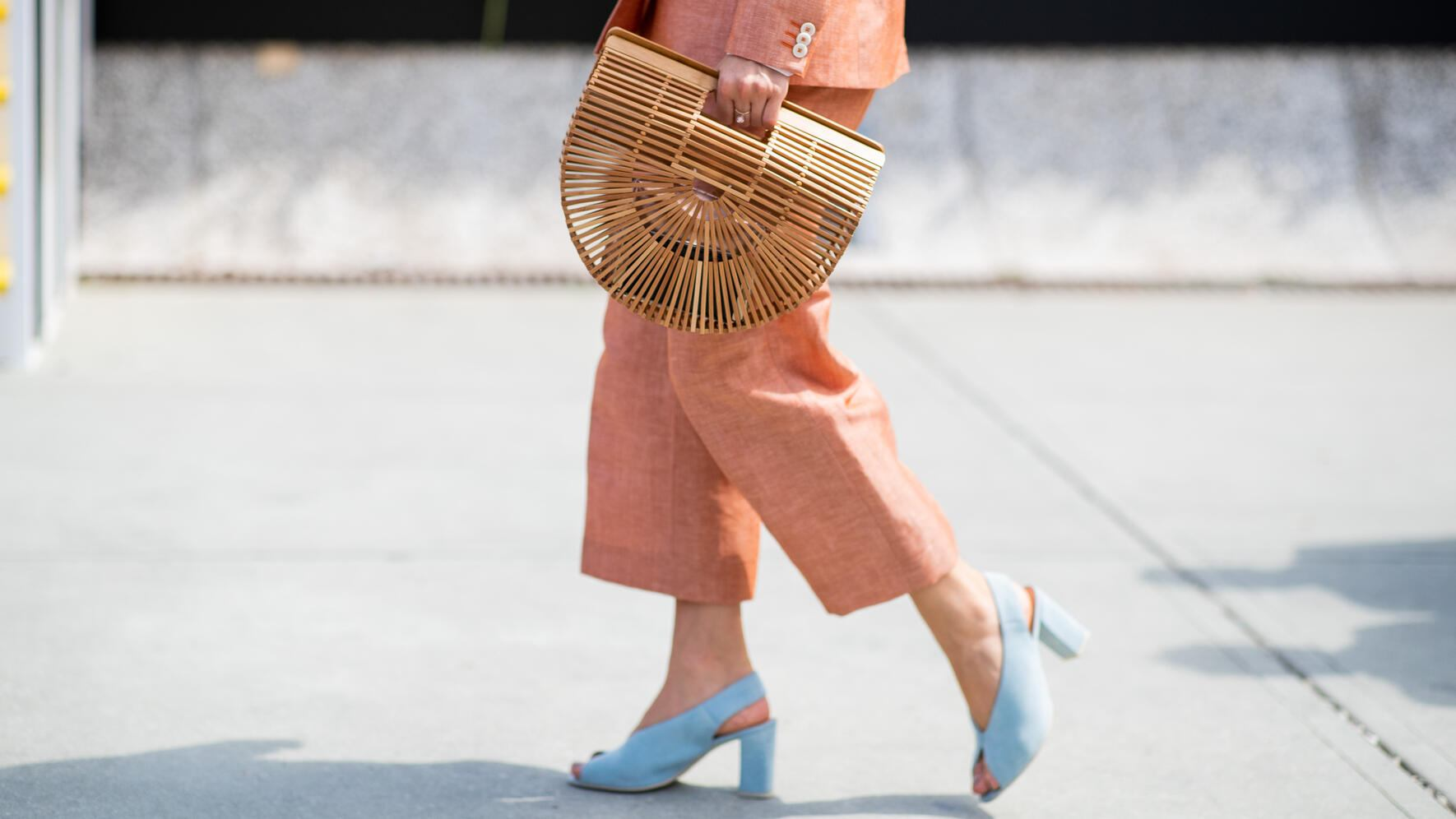 FLORENCE, ITALY - JUNE 12: Monika Kaminska wearing double breasted wool linen suit, white shirt, white pocket square cult gaia bag, Dolce and Gabbana sunglasses is seen during the 94th Pitti Immagine Uomo on June 12, 2018 in Florence, Italy (Photo by Christian Vierig/Getty Images)