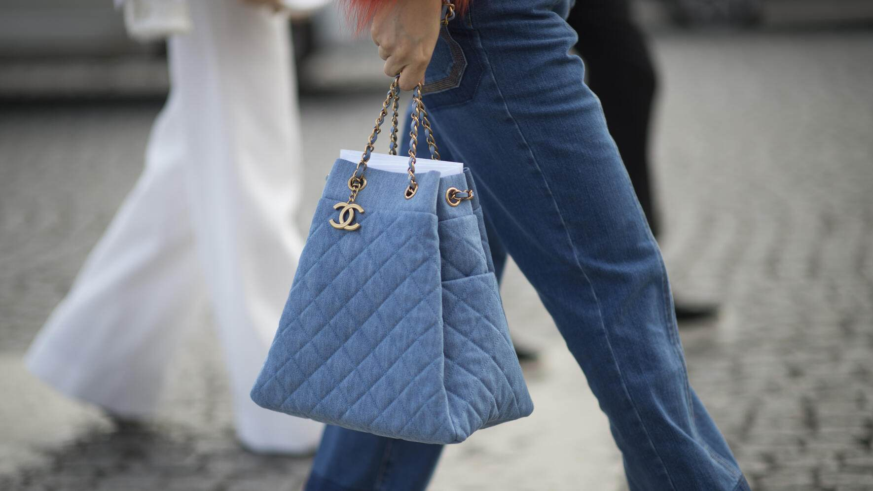 PARIS, FRANCE - MARCH 08:  A guest is wearing a Chanel bag seen in the streets of Paris during Paris Fashion Week Womenswear Fall/Winter 2016/2017 on March 8, 2016 in Paris, France.  (Photo by Timur Emek/Getty Images)