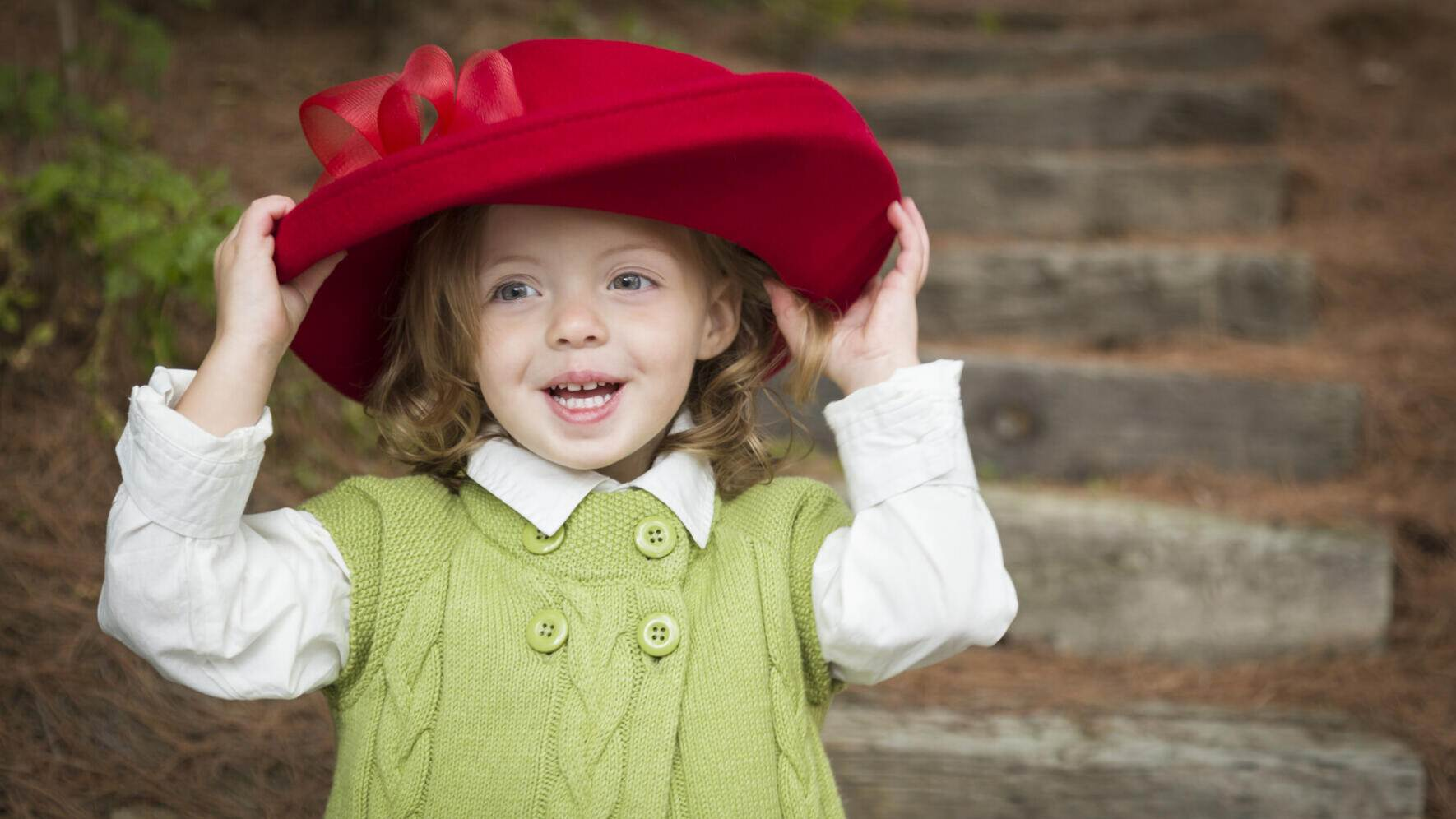 Child Girl with Red Hat Playing Outside
