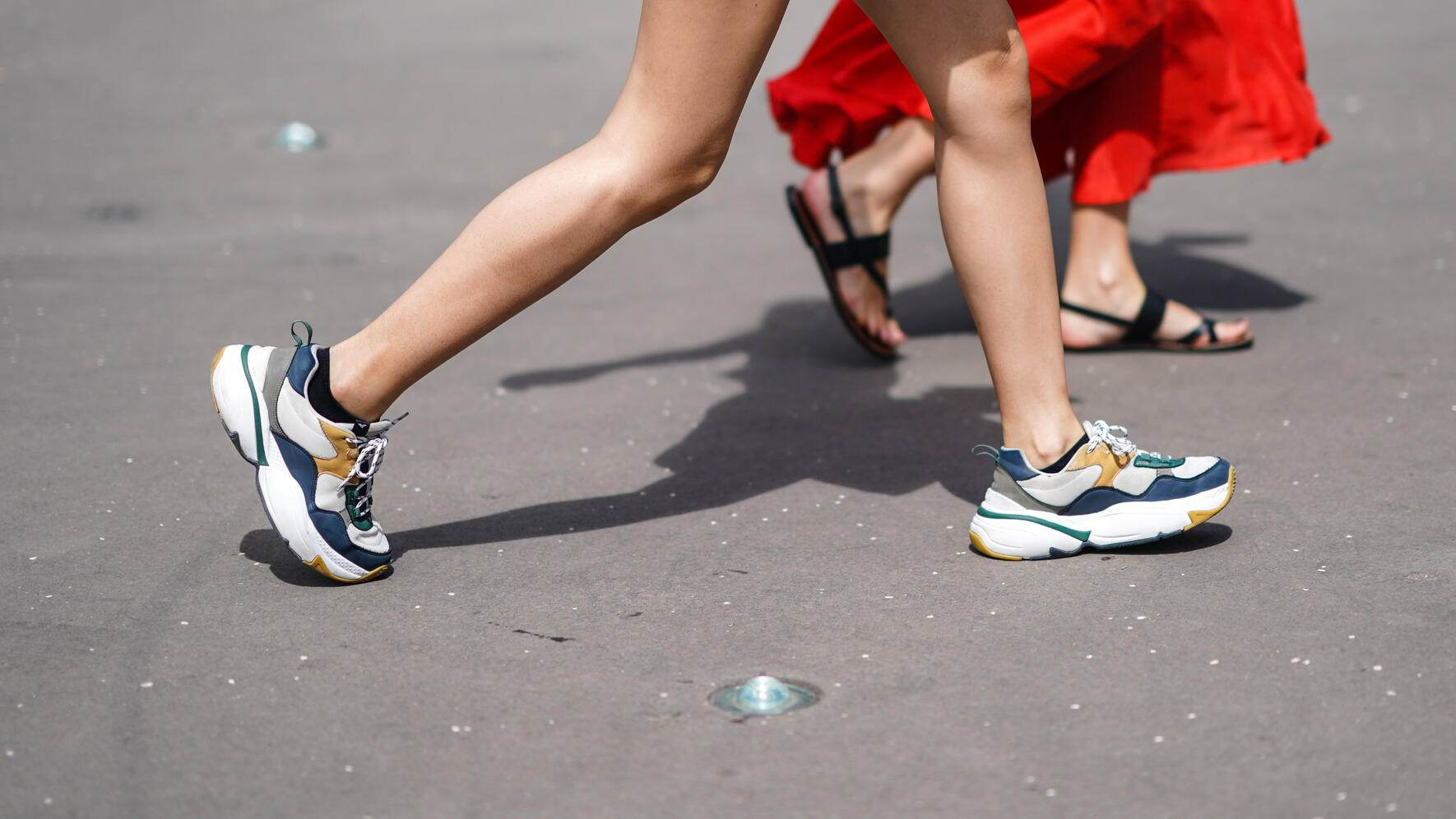 PARIS, FRANCE - JUNE 19: A guest wears colorful sneakers, outside Acne Studios, during Paris Fashion Week - Menswear Spring/Summer 2020, on June 19, 2019 in Paris, France. (Photo by Edward Berthelot/Getty Images)