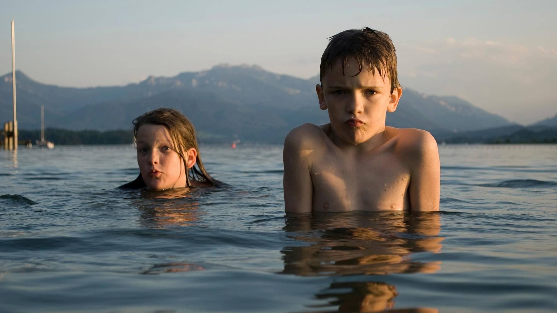 Children swimming in Lake Chiemsee, Bavaria, Germany, Europe