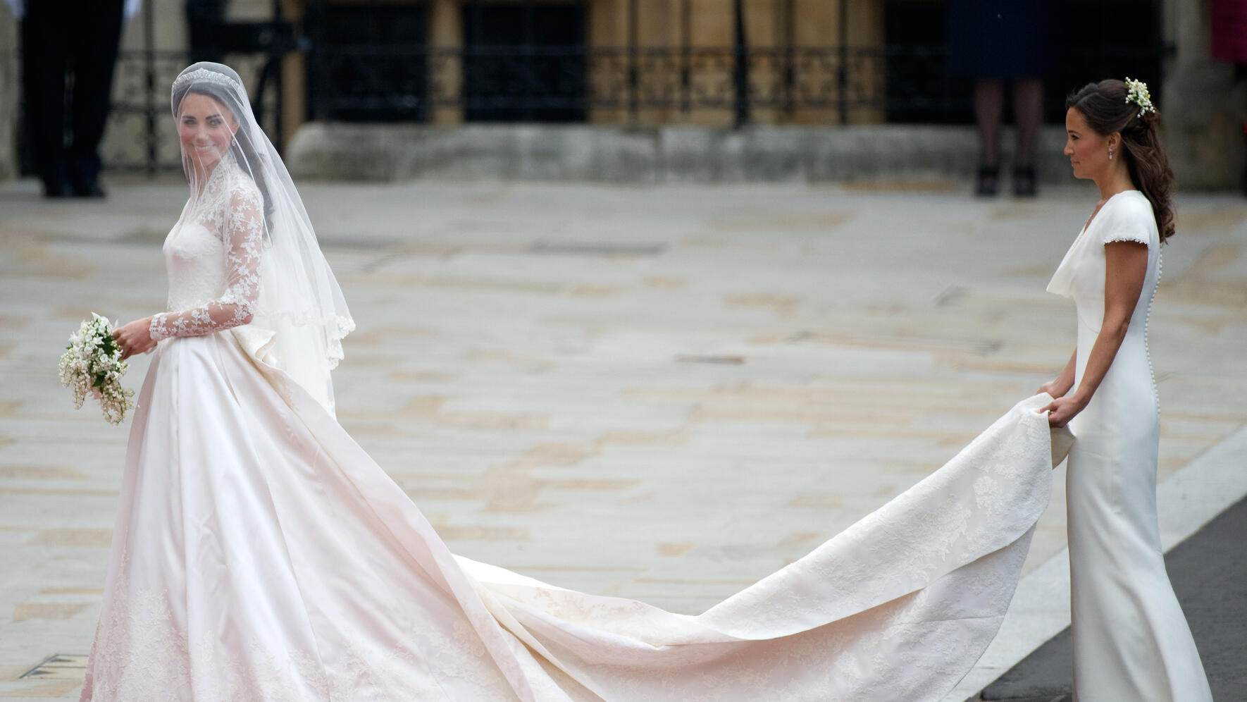 Catherine Middleton (L) and Pippa Middleton arrive for her wedding to Prince William, Duke of Cambridge at Westminster Abbey on April 29, 2011 in London, England. (Photo by Anwar Hussein/WireImage)