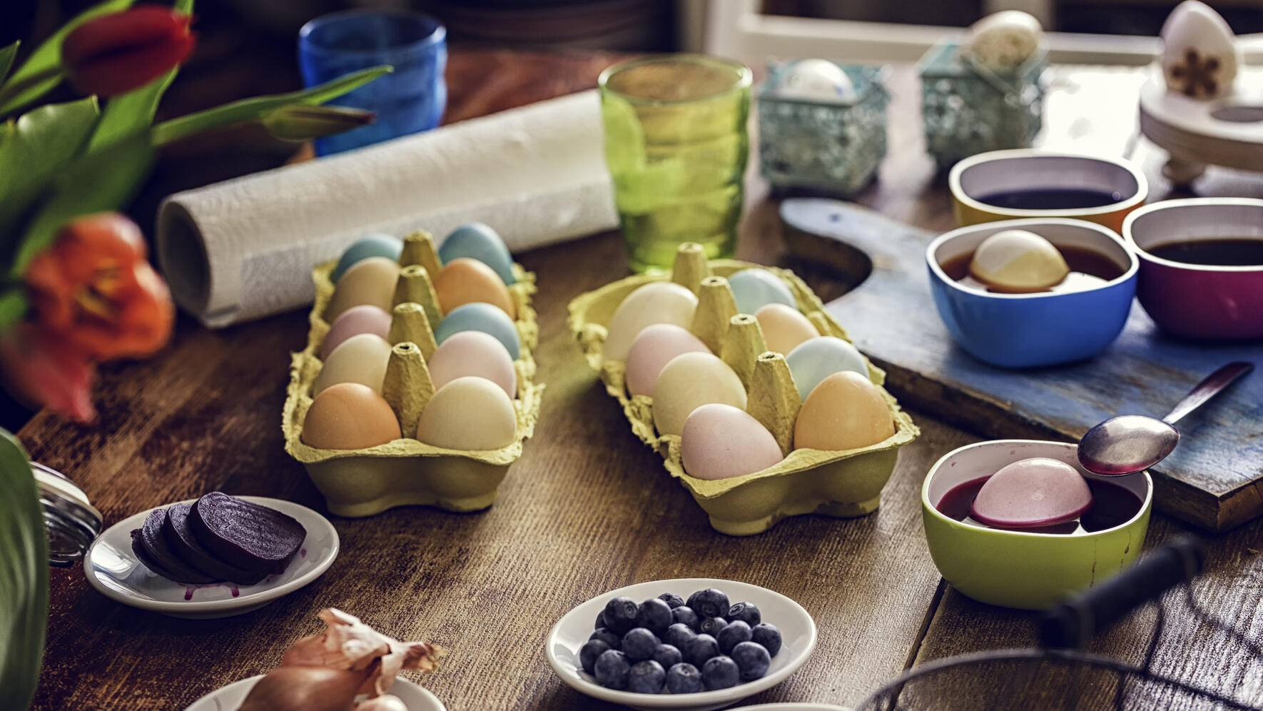 Naturally dyed Easter eggs with saffron, parsley, red cabbage, onion, red wine, blueberry, coffee, beet, carrot tumeric and spinach
