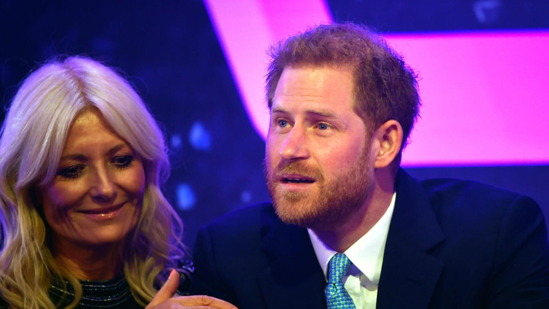 LONDON, ENGLAND - OCTOBER 15: Prince Harry, Duke of Sussex reacts next to television presenter Gaby Roslin as he delivers a speech during the WellChild awards at Royal Lancaster Hotel on October 15, 2019 in London, England. (Photo by Toby Melville - WPA Pool/Getty Images)