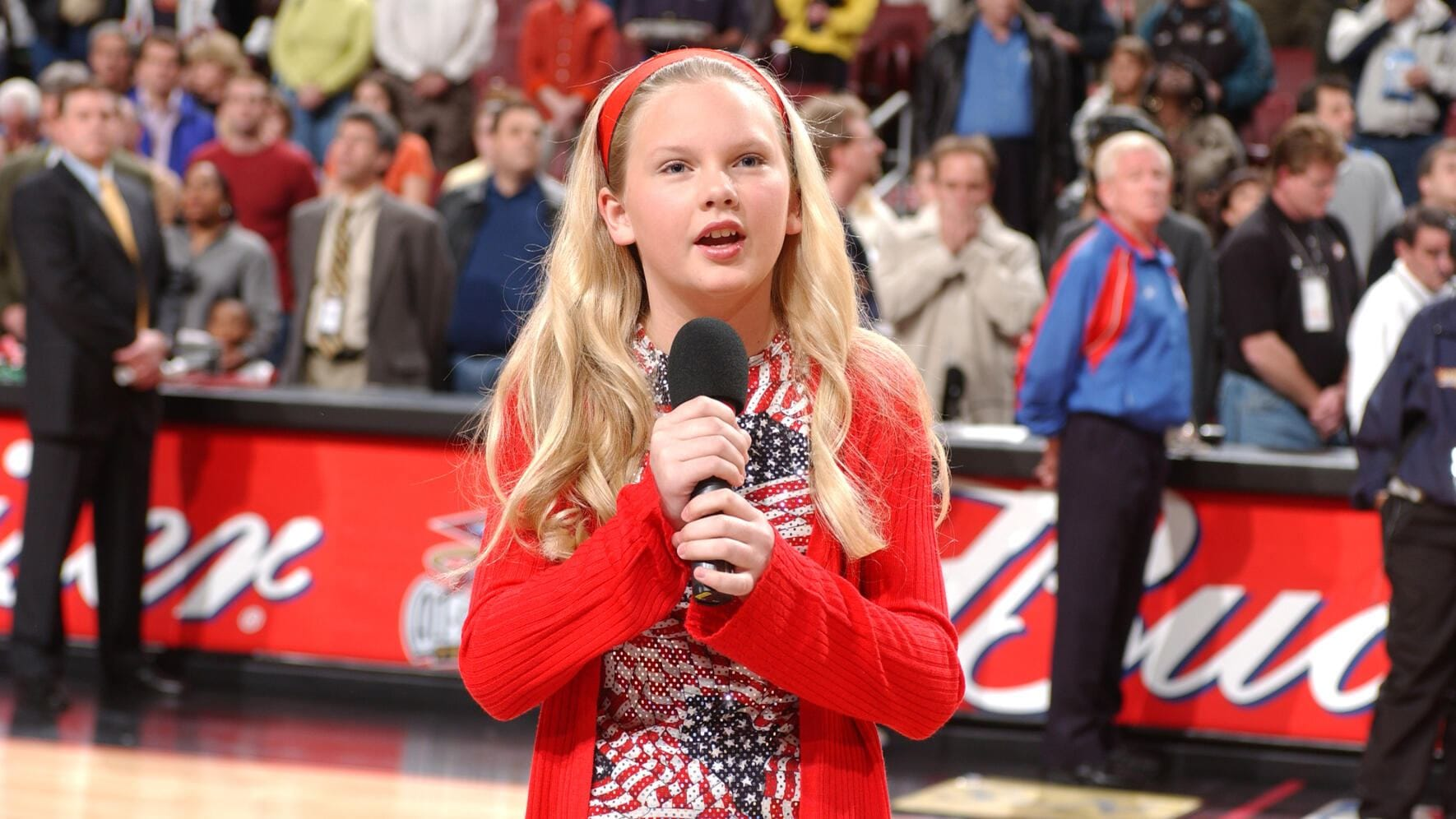 PHILADELPHIA, PA - APRIL 5: Performer Taylor Swift sings the National Anthem prior to the game of the Detroit Pistons against the Philadelphia 76ers on April 5, 2002 at the Comcast Center in Philadelphia, Pennsylvania. NOTE TO USER: User expressly acknowledges and agrees that, by downloading and/or using this Photograph, user is consenting to the terms and conditions of the Getty Images License Agreement. Mandatory Copyright Notice: Copyright 2014 NBAE (Photo by Jesse D. Garrabrant/NBAE via Getty Images)
