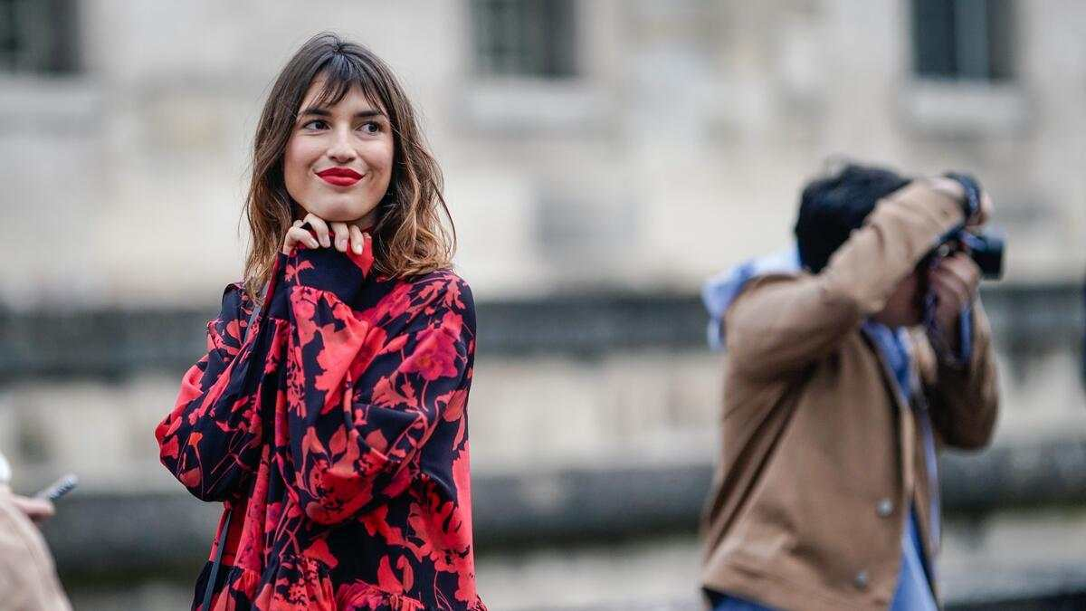PARIS, FRANCE - MARCH 03: Jeanne Damas wears a black and red floral print dress, outside Valentino, during Paris Fashion Week Womenswear Fall/Winter 2019/2020, on March 03, 2019 in Paris, France. (Photo by Edward Berthelot/Getty Images)