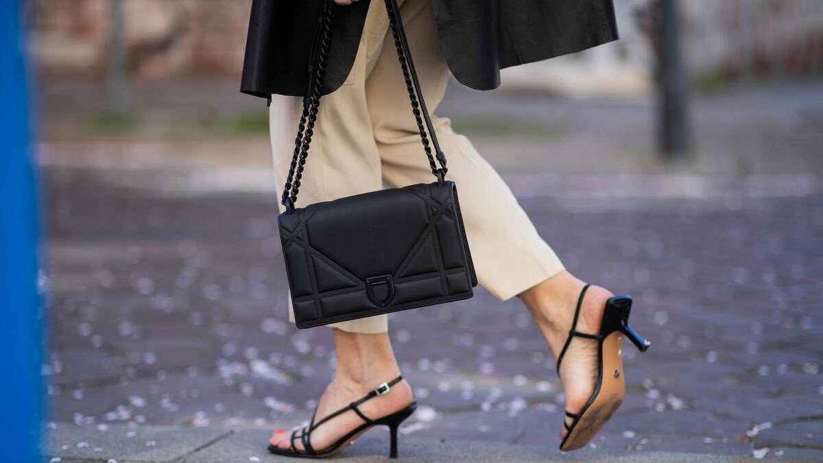 BERLIN, GERMANY - APRIL 23: Sonia Lyson is seen wearing beige Massimo Dutti pants, Zara sandals, Uterque leather cape, black Dior bag on April 23, 2019 in Berlin, Germany. (Photo by Christian Vierig/Getty Images)