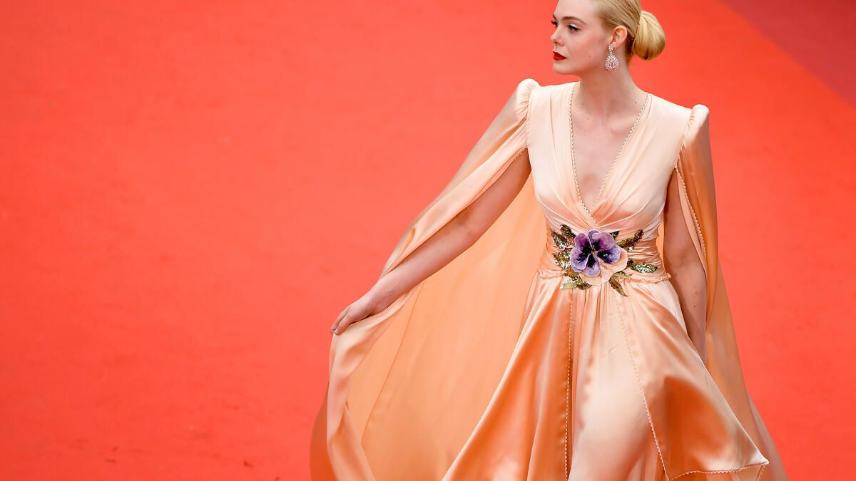 """CANNES, FRANCE - MAY 14: Jury Member Elle Fanning, wearing Chopard jewels, attends the opening ceremony and screening of """"The Dead Don't Die"""" during the 72nd annual Cannes Film Festival on May 14, 2019 in Cannes, France. (Photo by Matt Winkelmeyer/Getty Images)"""