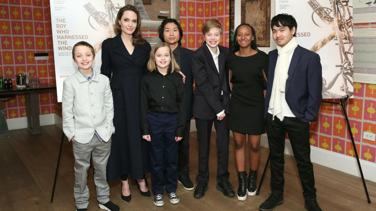 "NEW YORK, NEW YORK - FEBRUARY 25: Angelina Jolie with children Knox Leon Jolie-Pitt, Vivienne Marcheline Jolie-Pitt, Pax Thien Jolie-Pitt, Shiloh Nouvel Jolie-Pitt, Zahara Marley Jolie-Pitt and Maddox Chivan Jolie-Pitt attend ""The Boy Who Harnessed The Wind"" Special Screening at Crosby Street Hotel on February 25, 2019 in New York City. (Photo by Monica Schipper/Getty Images for Netflix)"
