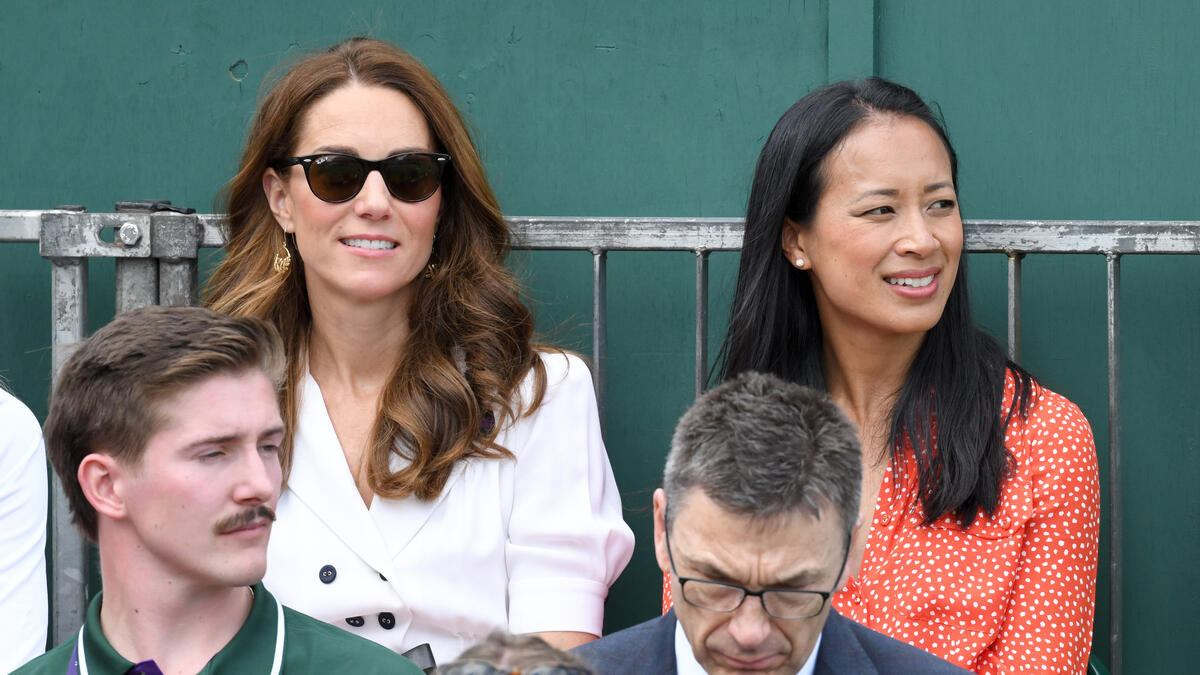 LONDON, ENGLAND - JULY 02: Catherine, Duchess of Cambridge and Anne Keothavong (R) smile as they attend day 2 of the Wimbledon Tennis Championships at the All England Lawn Tennis and Croquet Club on July 02, 2019 in London, England. (Photo by Karwai Tang/Getty Images)