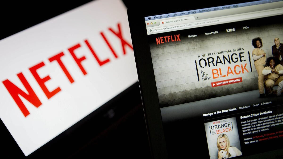 "The Netflix Inc. website displays the ""Orange is the New Black"" series on a laptop computer in this arranged photograph in Washington, D.C., U.S., on Thursday, July 10, 2014. ""House of Cards,"" and ""Orange Is the New Black,"" two Netflix Inc. series that have boosted the popularity of online viewing, will compete for television's top honors as nominees for Emmy awards in drama and comedy. Photographer: Andrew Harrer/Bloomberg via Getty Images"