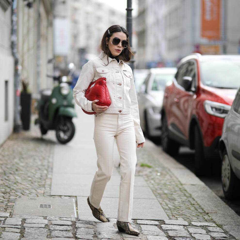 BERLIN, GERMANY - MARCH 19: Frankie Miles wearing white Denim jacket wrangler, White Jeans Wrangler, Ripped turtleneck subdued, Snakeprint Boots sandro, Glam slam quilted leather bag Maison Margiela, pilote sunglasses givenchy, Hair clips Asos on March 19, 2019 in Berlin, Germany. (Photo by Jeremy Moeller/Getty Images)