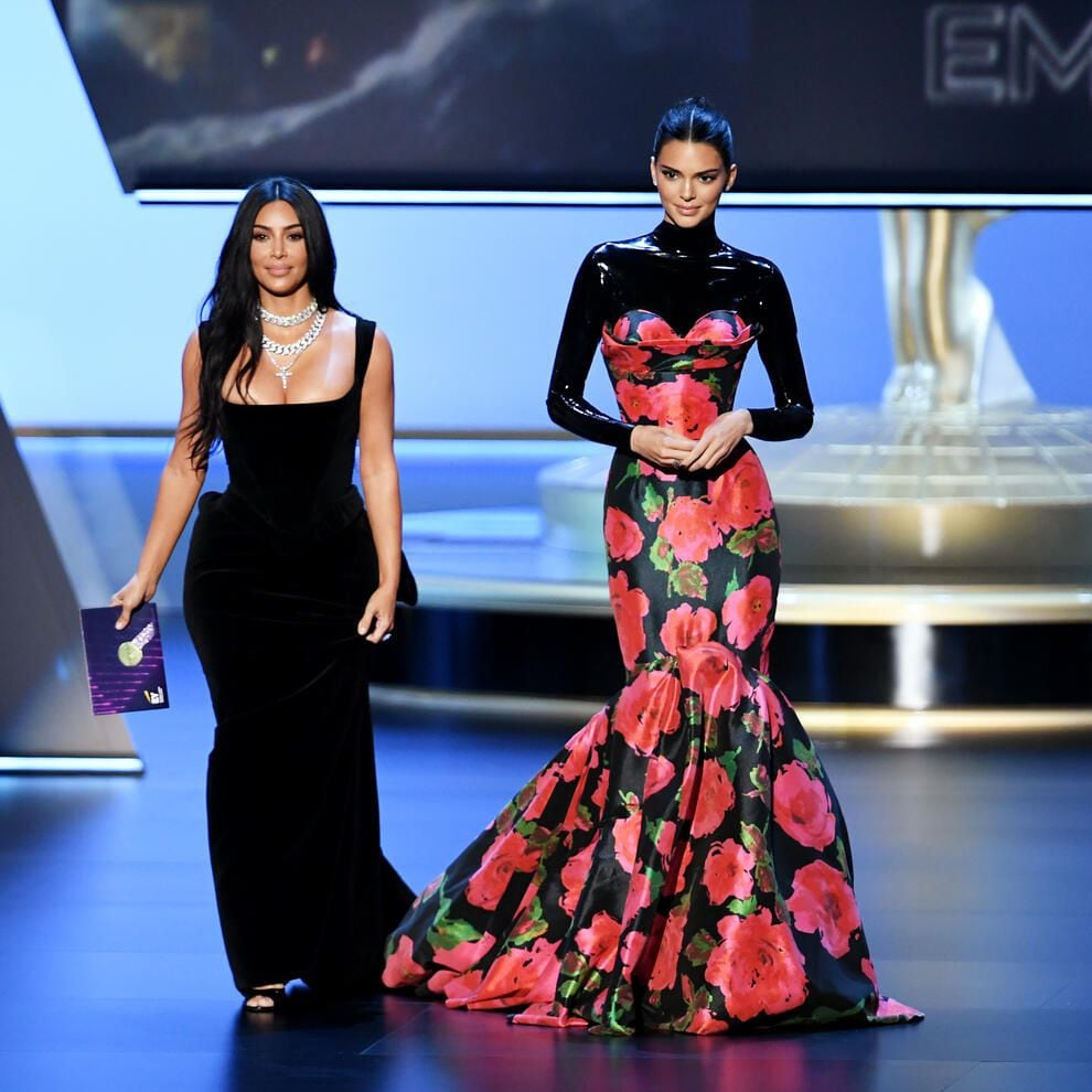 LOS ANGELES, CALIFORNIA - SEPTEMBER 22: (L-R) Kim Kardashian West and Kendall Jenner walk onstage during the 71st Emmy Awards at Microsoft Theater on September 22, 2019 in Los Angeles, California. (Photo by Kevin Winter/Getty Images)