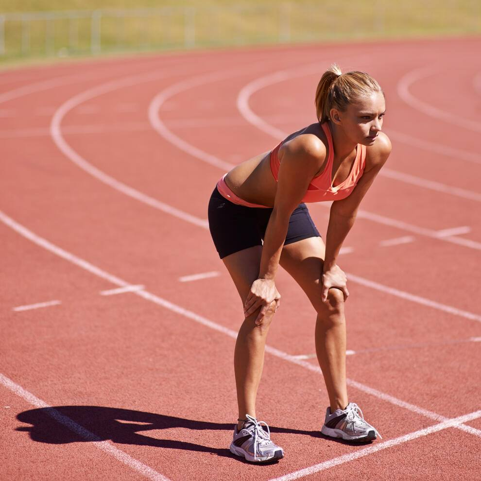 Shot of an attractive young runner out on the track