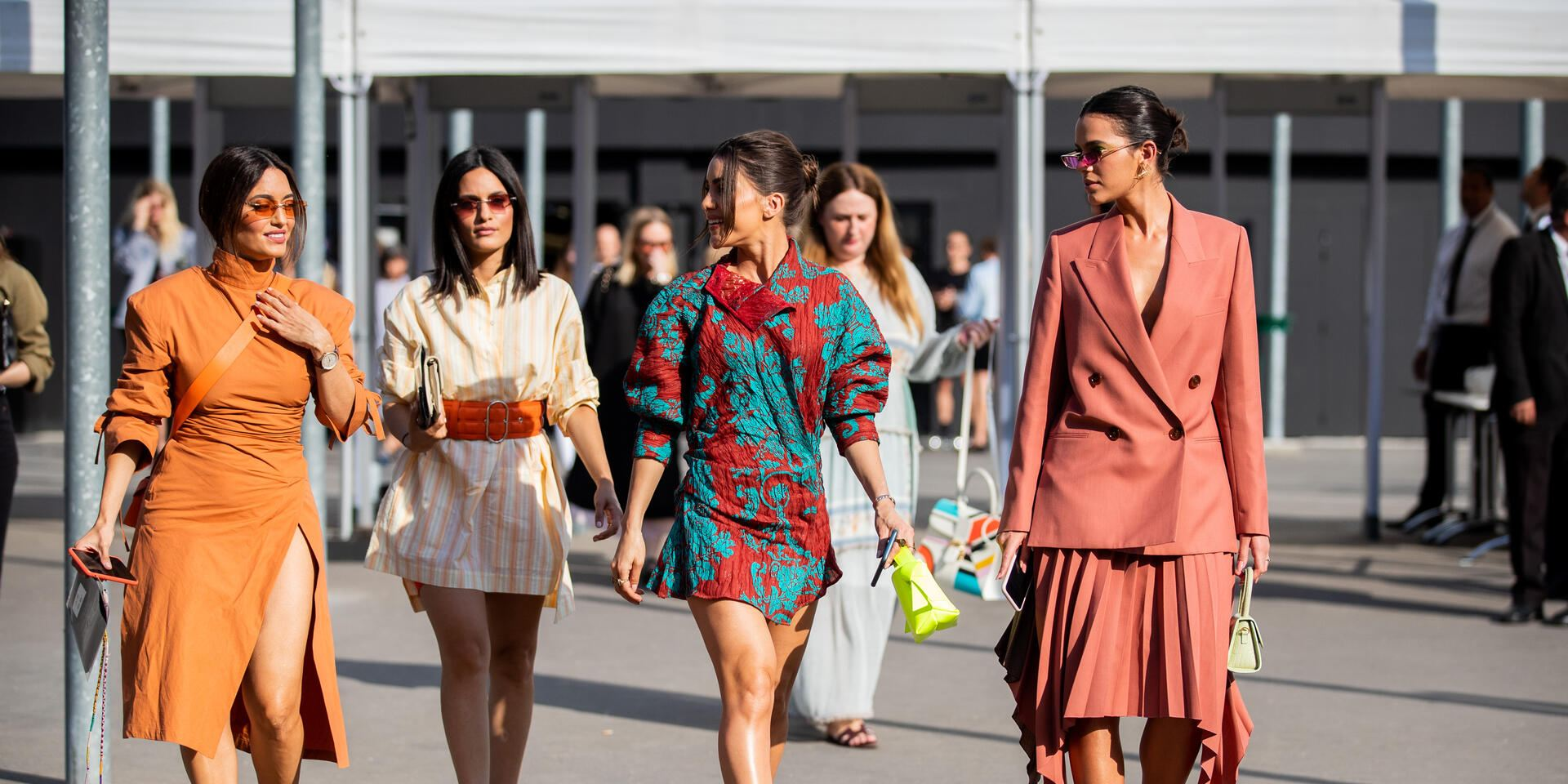 PARIS, FRANCE - JUNE 30: Andrea Wazen wearing yellow belted striped button shirt Karen Wazen is seen wearing orange dress, Camila Coelho and Bruna Marquezine outside Acne during Paris Fashion Week - Haute Couture Fall/Winter 2019/2020 on June 30, 2019 in Paris, France. (Photo by Christian Vierig/Getty Images)