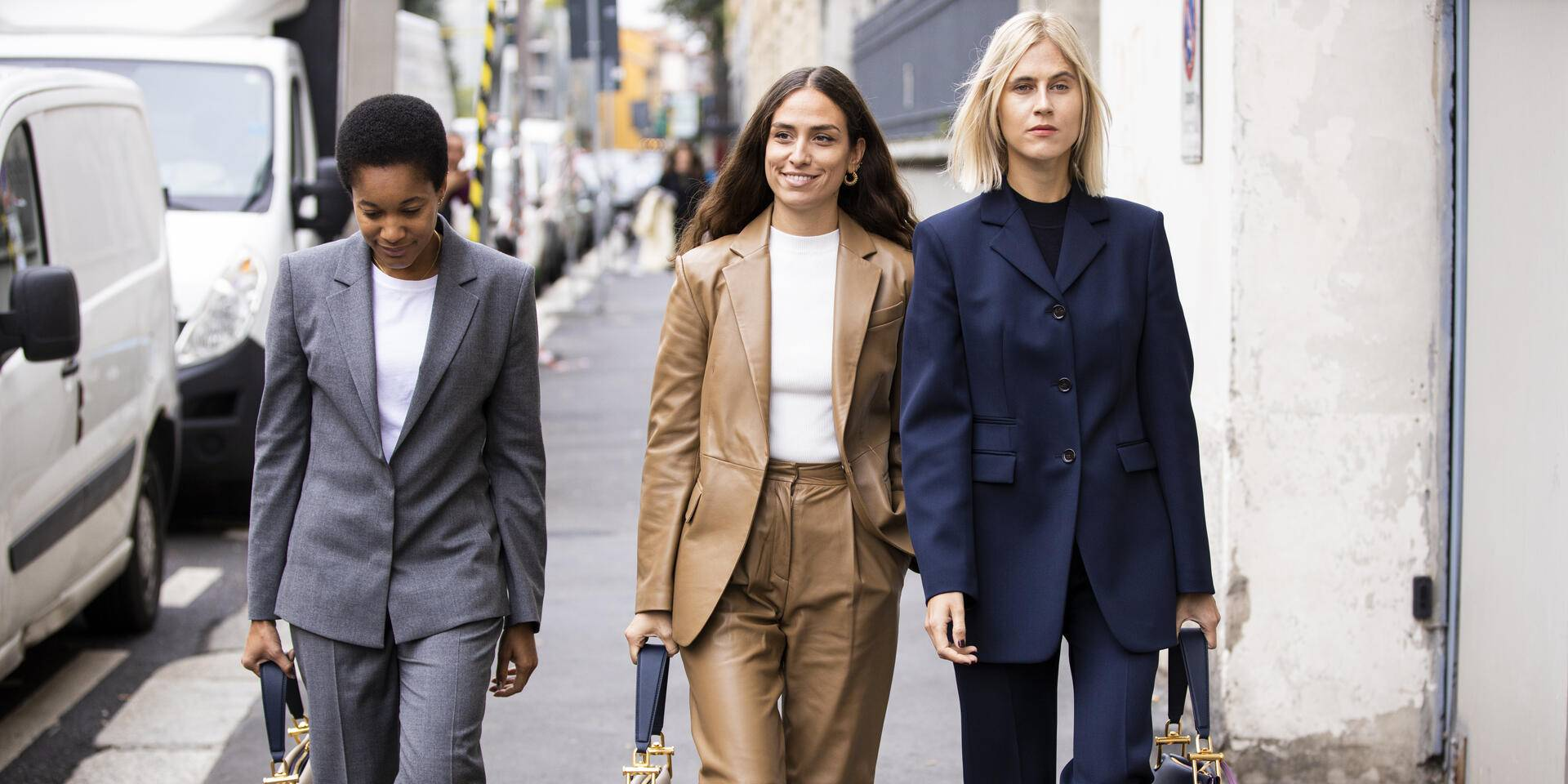 MILAN, ITALY - SEPTEMBER 22:  Tamu McPherson (L), Erika Boldrin (C) and Linda Tol (R), wearing suits and Hugo Boss bag, are seen outside the Hugo Boss show during Milan Fashion Week Spring/Summer 2020 on September 22, 2019 in Milan, Italy. (Photo by Claudio Lavenia/Getty Images)