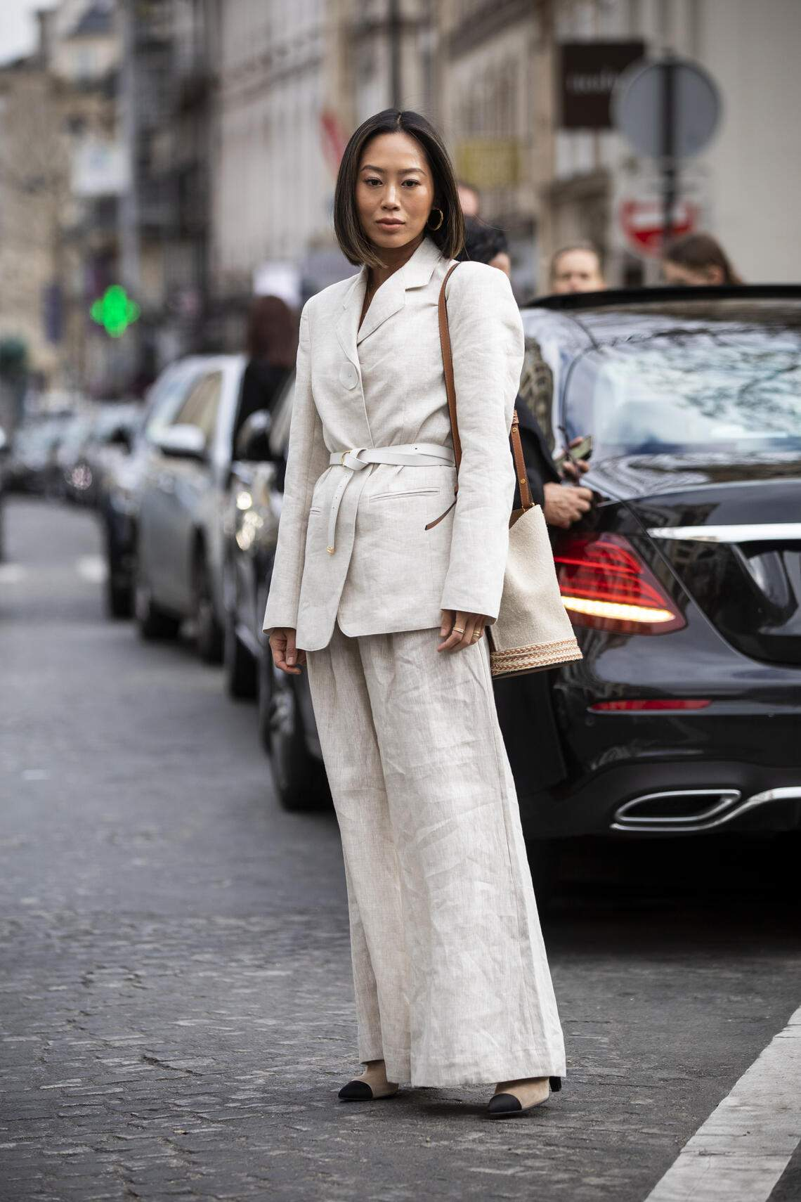 PARIS, FRANCE - MARCH 02: Aimee Song, wearing a cream suit and black heels, is seen outside Elie Saab on Day 6 Paris Fashion Week Autumn/Winter 2019/20 on March 2, 2019 in Paris, France. (Photo by Claudio Lavenia/Getty Images)