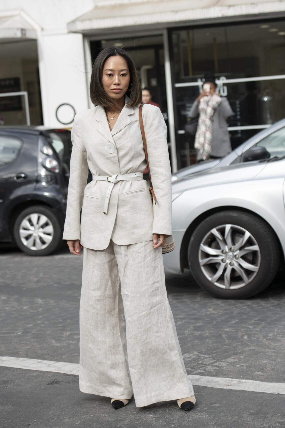 PARIS, FRANCE - MARCH 02: Digital Influencer Aimee Song wears a Loewe bag, linen suit and Chanel shoes on March 02, 2019 in Paris, France. (Photo by Kirstin Sinclair/Getty Images)