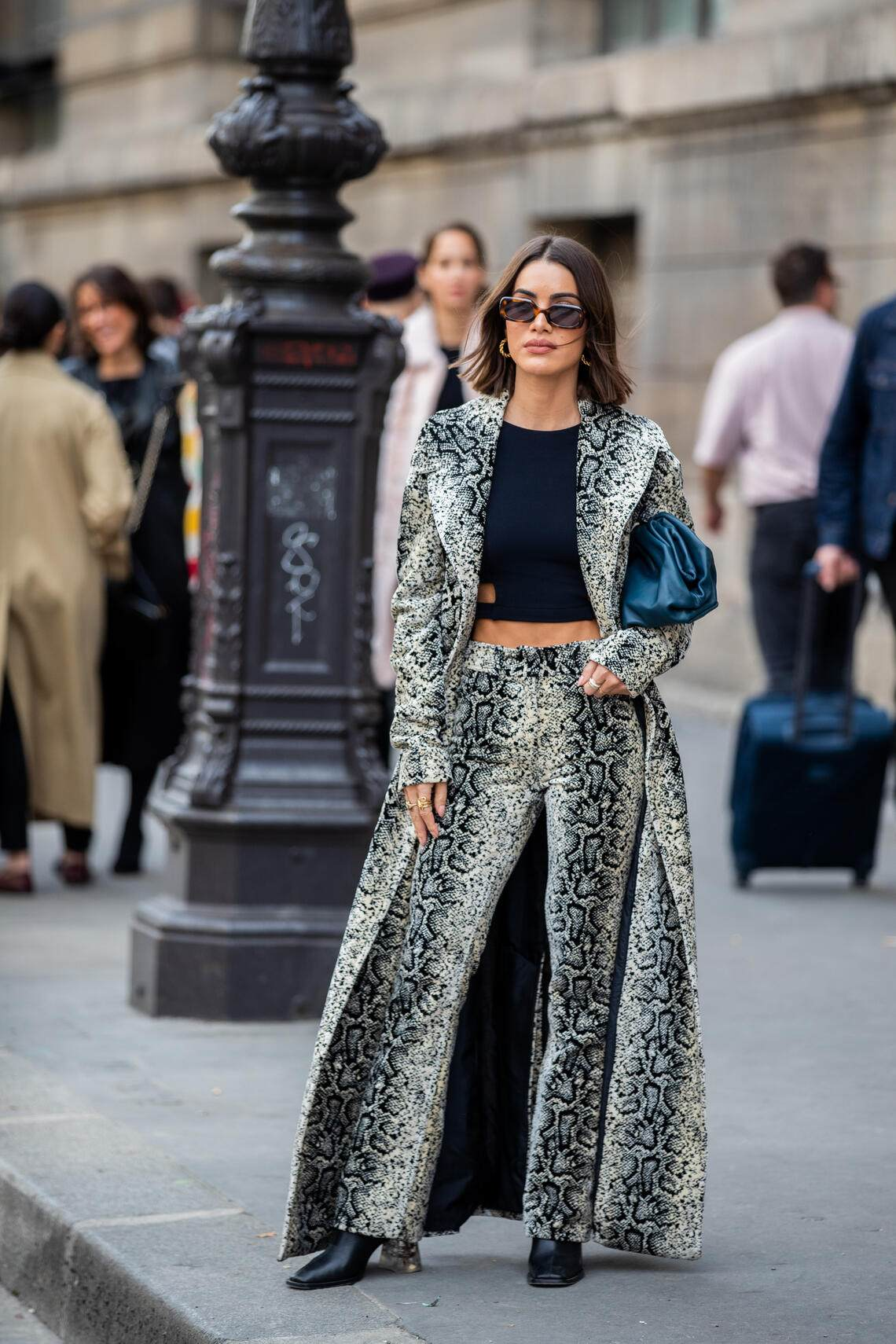 PARIS, FRANCE - SEPTEMBER 30: Camila Coelho seen wearing cropped top, coat and pants with snake print, clutch outside Giambattista Valli during Paris Fashion Week Womenswear Spring Summer 2020 on September 30, 2019 in Paris, France. (Photo by Christian Vierig/Getty Images)