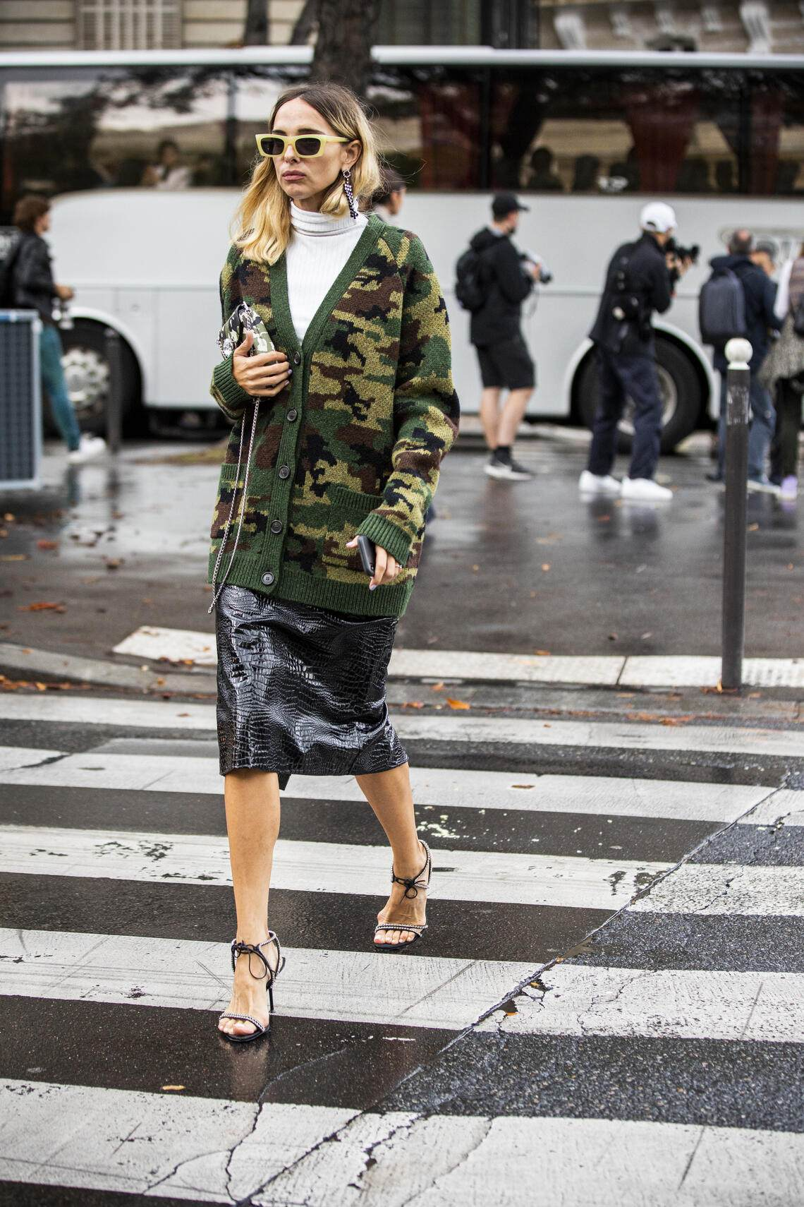 PARIS, FRANCE - OCTOBER 01: Candela Pelizza, wearing a long military print cardigan and black leather midi skirt, is seen outside the Miu Miu show during Paris Fashion Week - Womenswear Spring Summer 2020 on October 01, 2019 in Paris, France. (Photo by Claudio Lavenia/Getty Images)
