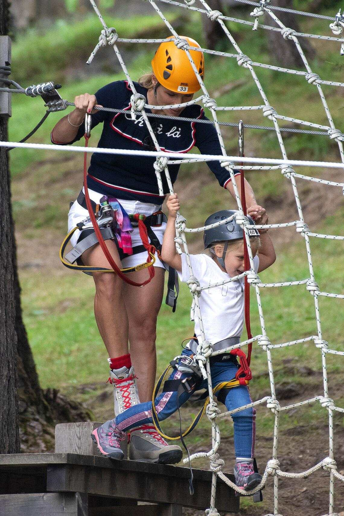 Michelle Hunziker has fun at the Adventure Park of Colfosco with daughters Sole and Celeste, while husband Tomaso Trussardi greets them from helicopter.22 Aug 2019Pictured: Michelle Hunziker   and Celeste Trussardi.Photo credit: MEGATheMegaAgency.com+1 888 505 6342