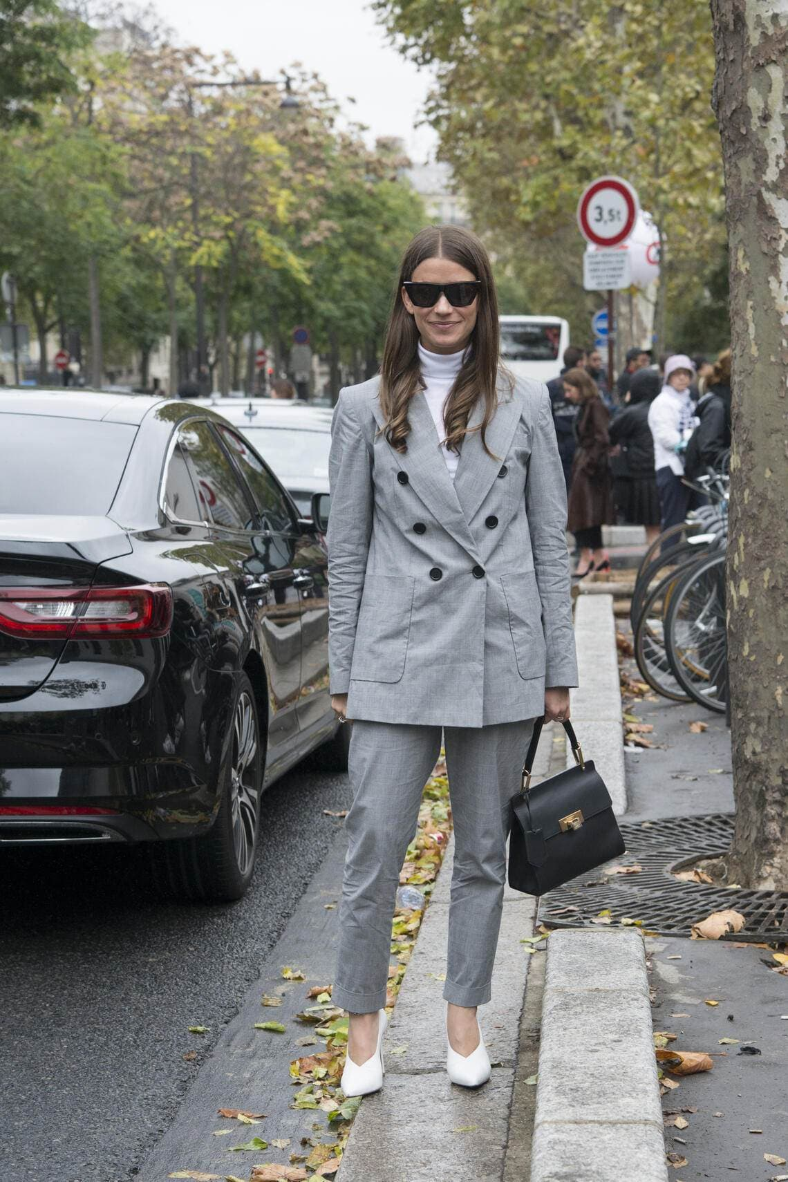 PARIS, FRANCE - OCTOBER 1 : Accessories Director at Harper's Bazaar US Amanda Alagem wears an Isabel Marant suit, Balenciaga bag, Celine sunglasses and Alexandre Birman shoes day 6 of Paris Womens Fashion Week Spring/Summer 2018, on October 1, 2017 in London, England. (Photo by Kirstin Sinclair/Getty Images)