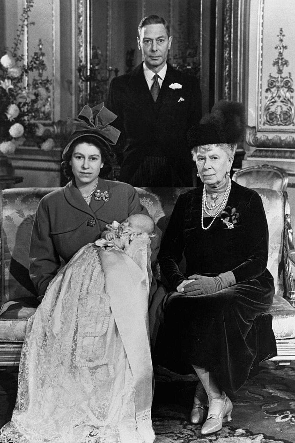 Four generations of the Royal Family pose for a photograph after the christening of Princess Elizabeth's baby son, Prince Charles. The baby's grandfather, King George VI and great grandmother, Queen Mary are present. (Photo by © Hulton-Deutsch Collection/CORBIS/Corbis via Getty Images)