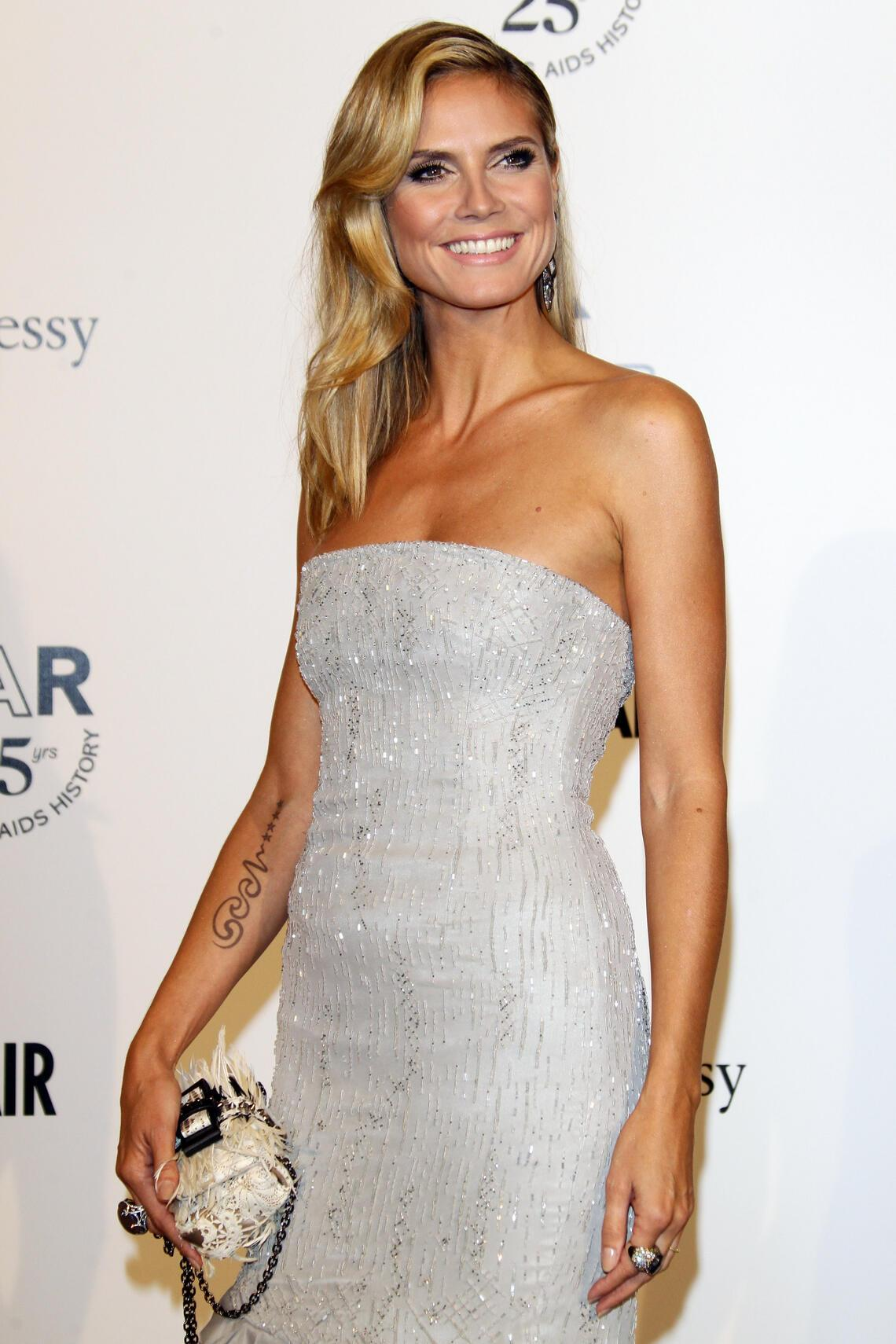 MILAN, ITALY - SEPTEMBER 23:  Model Heidi Klum attends amfAR MILANO 2011 at La Permanente on September 23, 2011 in Milan, Italy.  (Photo by Vittorio Zunino Celotto/Getty Images for amfAR)