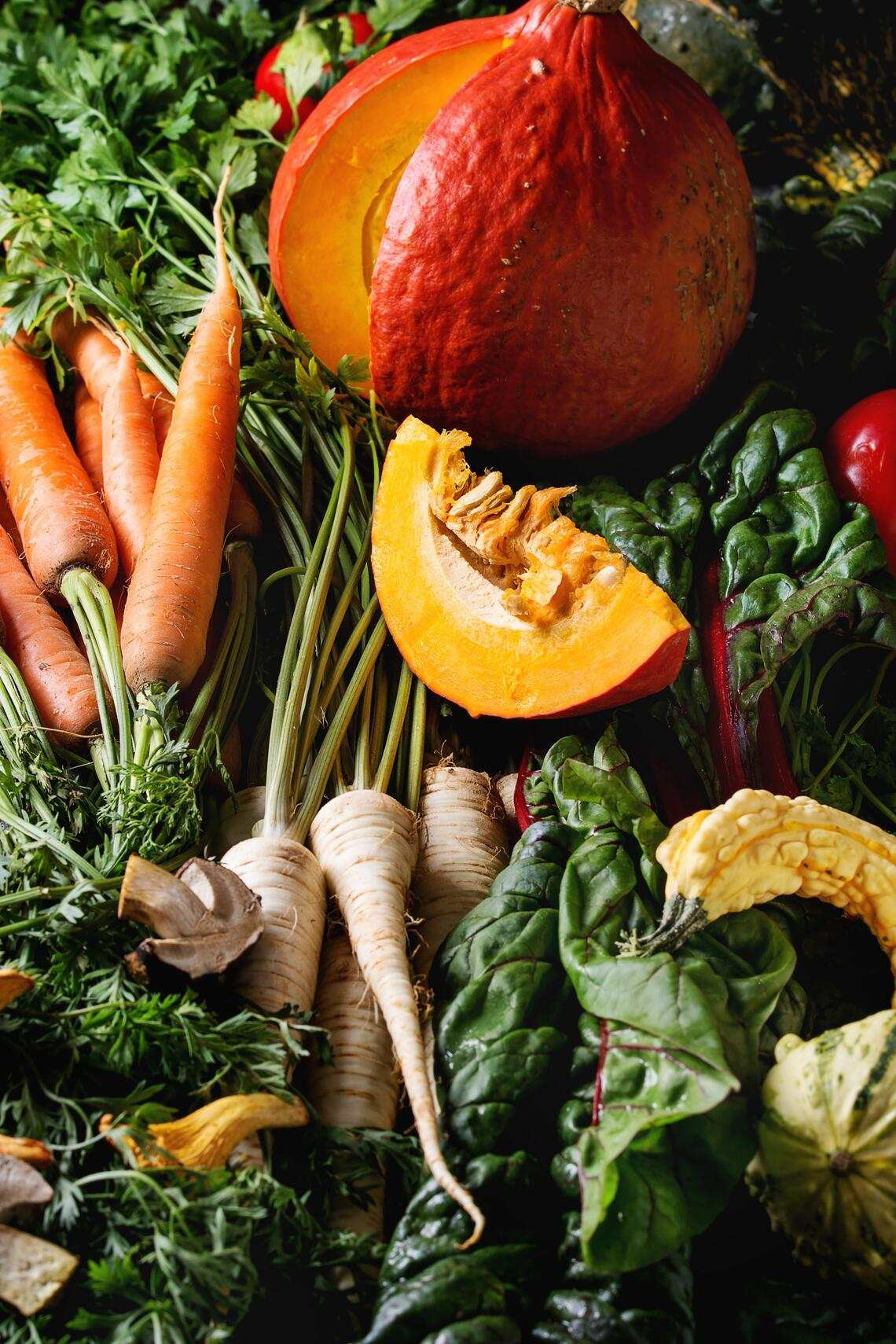 Variety of autumn harvest vegetables carrot, parsnip, chard, paprika, hokkaido pumpkin, porcini and chanterelles mushrooms. Fall harvest concept. Close up. (Photo by: Natasha Breen/REDA&CO/Universal Images Group via Getty Images)