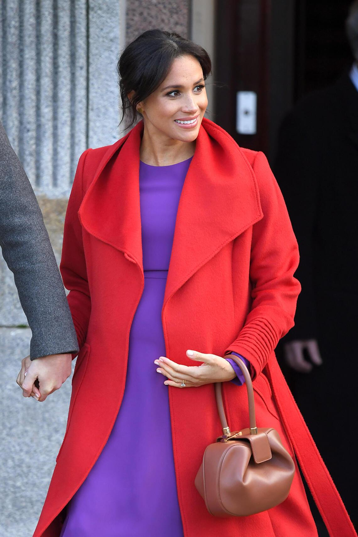 Meghan Markle in Rot und Lila